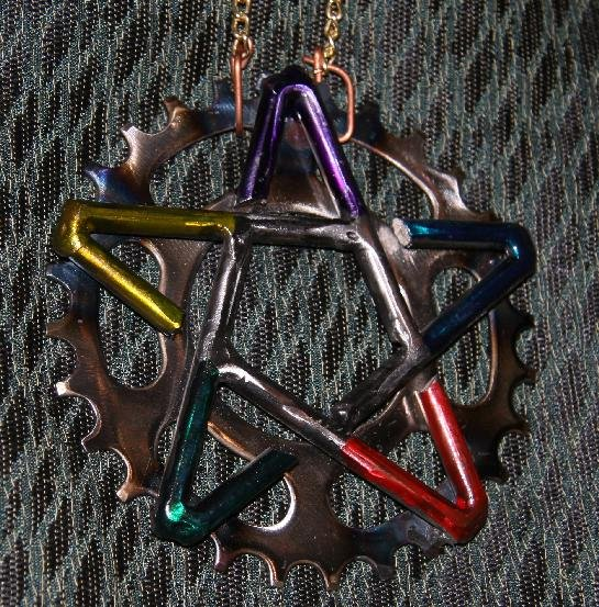 Necklace with steel pentacle on bicycle gear